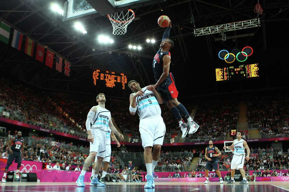 LONDON, ENGLAND - AUGUST 06: Russell Westbrook #7 of United States dunks the ball over Juan Gutierrez #9 of Argentina during the Men's Basketball Preliminary Round match on Day 10 of the London 2012 Olympic Games at the Basketball Arena on August 6, 2012 in London, England.