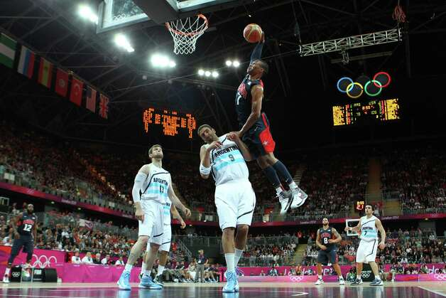 LONDON, ENGLAND - AUGUST 06:  Russell Westbrook #7 of United States dunks the ball over Juan Gutierrez #9 of Argentina during the Men's Basketball Preliminary Round match on Day 10 of the London 2012 Olympic Games at the Basketball Arena on August 6, 2012  in London, England. Photo: Christian Petersen, Getty Images / 2012 Getty Images