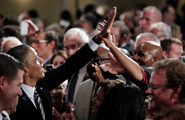 President Barack Obama greets supporters in the audience after speaking at a campaign fundraiser in Stamford, Conn., Monday, Aug., 6, 2012. (AP Photo/Pablo Martinez Monsivais) Photo: Associated Press