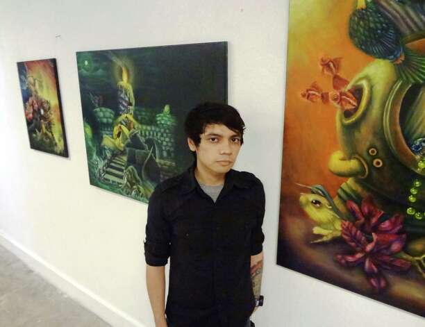 "San Antonio artist Samuel Velasquez draws on everything from paranormal Web sites to mythology for inspiration for his otherworldly paintings. ""I'm attracted to the fantastical,"" he said. ""I like ghost stories and Bigfoot sightings and UFO abductions and weird things like that."" Photo: Photo By Steve Bennett"