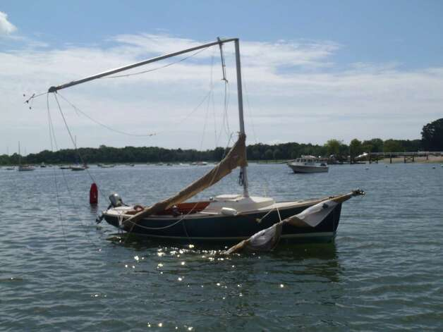 A sailboat  at Greenwich Cove Monday, Aug. 6, 2012, after being tossed about by a violent storm that struck Greenwich Sunday night. Photo: Contributed Photo