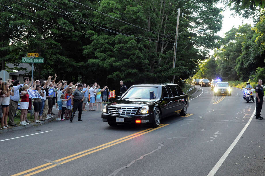 The motorcade carrying President Barack Obama travels along Beachside Avenue en route to the home of Harvey Weinstein for a fundraiser in Westport, Conn., Monday, August 6, 2012. Photo: Keelin Daly / Stamford Advocate