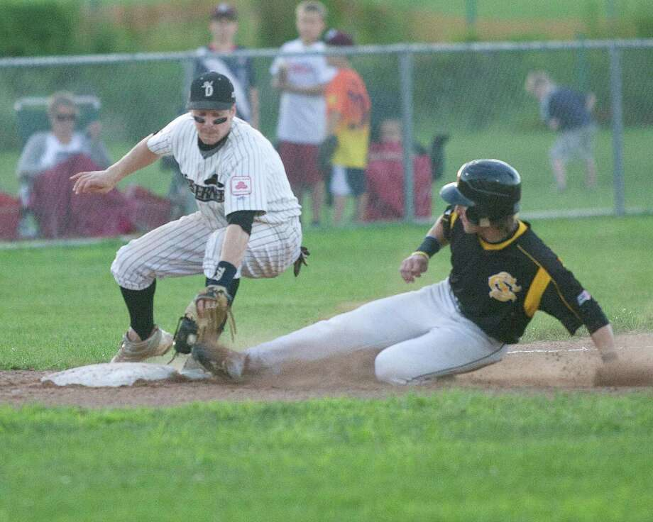 Westerners third baseman Mathew Boulter tags North Adams' Jeff Roy out trying to steal during the deciding game of the NECBL Western Division playoffs Monday night at Rogers Park. Photo: Barry Horn / The News-Times Freelance