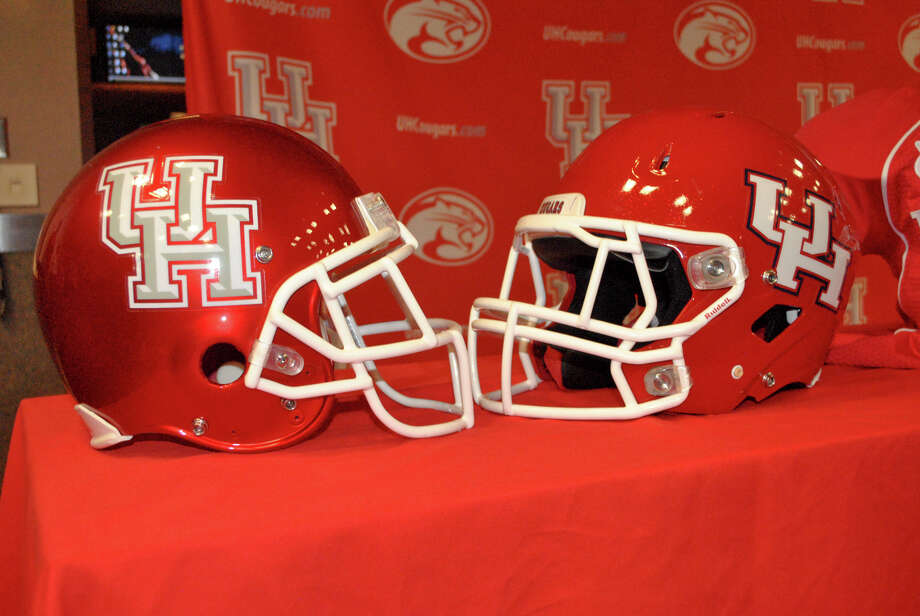 UH unveiled a few changes to its game-day look Monday, including a redesigned helmet. The helmet features a metallic-based red and the school's updated logo. A shoulder patch the Cougars are wearing will commemorate the school's final season of playing at Robertson Stadium. Photo: Handout