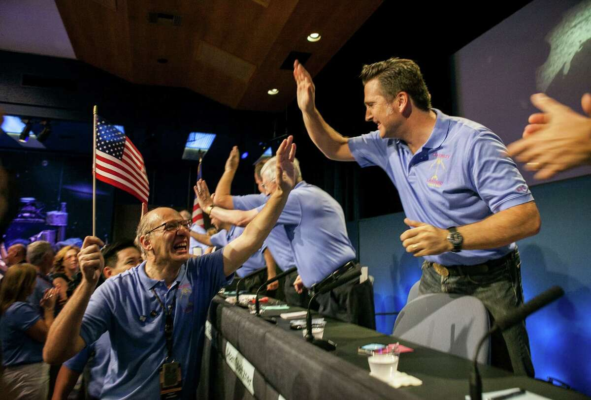 Tension turns to joy for Mars Science Laboratory members Miguel San Martin, left, and Adam Steltzner at NASA's Jet Propulsion Laboratory in Pasadena, Calif., early Monday after the Curiosity rover successfully lands on Mars.