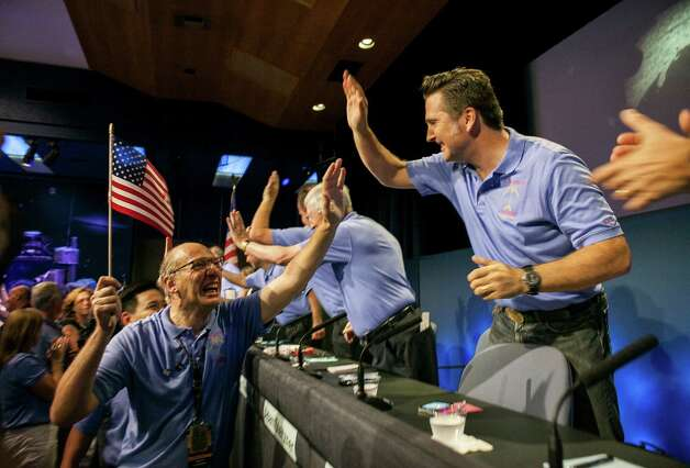 Tension turns to joy for Mars Science Laboratory members Miguel San Martin, left, and Adam Steltzner at NASA's Jet Propulsion Laboratory in Pasadena, Calif., early Monday after the Curiosity rover successfully lands on Mars. Photo: Damian Dovarganes / AP