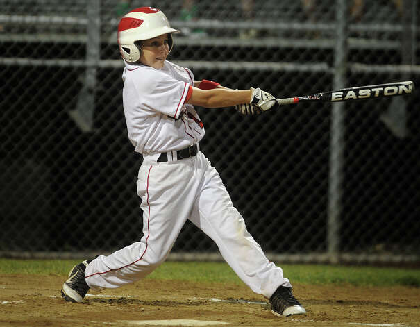 Fairfield American's Kevin Oricoli gets a base hit during the first inning of their game with Scarborough, Maine at the 2012 Little League Eastern Regional in Bristol on Monday, August 6, 2012. Photo: Brian A. Pounds / Connecticut Post