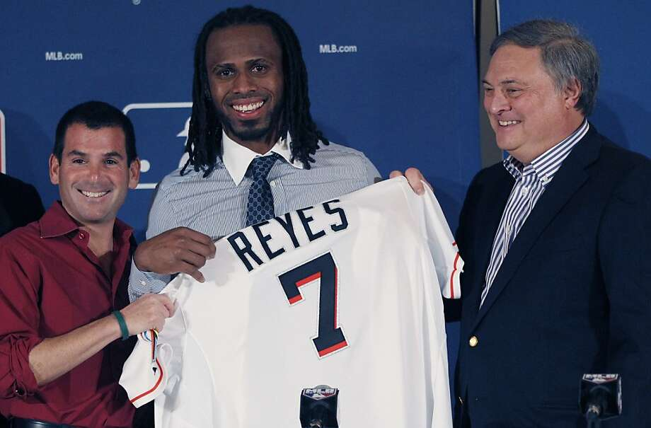 Miami Marlins  owner Jeffrey Loria, right, and team president David Samson, left, posse with new Marlins Jose Reyes during a news conference at the Major League Baseball 2011 Winter Meetings in Dallas,  Wednesday, Dec. 7, 2011.  The Marlins unveiled the newly signed free-agent shortstop Reyes. Photo: LM Otero, Associated Press