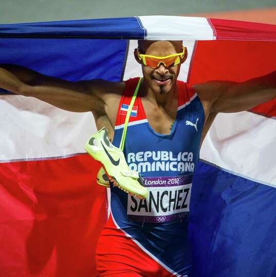 Felix Sanchez of the Dominican Republic celebrates after winning the men's 400-meter hurdles final a