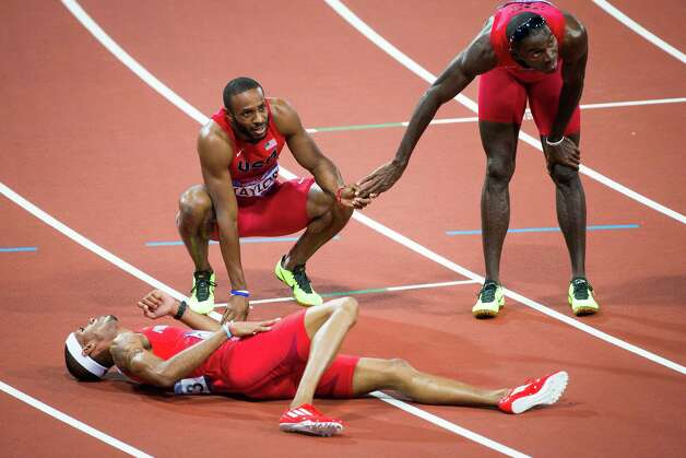 Kerron Clement of the USA, right, reacts after the finish of the men's 400-meter hurdles final with Angelo Taylor of the USA and Javier Culson of Puerto Rico at the 2012 London Olympics on Monday, Aug. 6, 2012. Culson took bronze in the event. Taylor finished in fifth. Clement finished in 8th place. Photo: Smiley N. Pool, Houston Chronicle / © 2012  Houston Chronicle