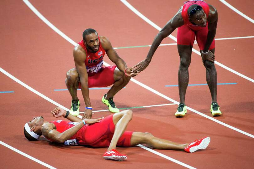 Kerron Clement of the USA, right, reacts after the finish of the men's 400-meter hurdles final with