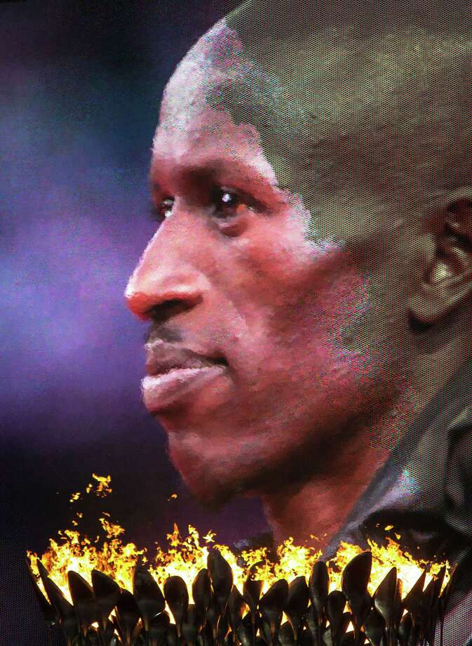 Men's 3000-meter steeplechase gold medalist Ezekiel Kemboi of Kenya is seen on a video screen above the Olympic flame during medal ceremony at the 2012 London Olympics on Monday, Aug. 6, 2012. Photo: Smiley N. Pool, Houston Chronicle / © 2012  Houston Chronicle
