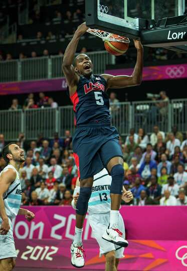 USA's Kevin Durant slams home two points past Argentina's Manu Ginobili during a men's basketball pr