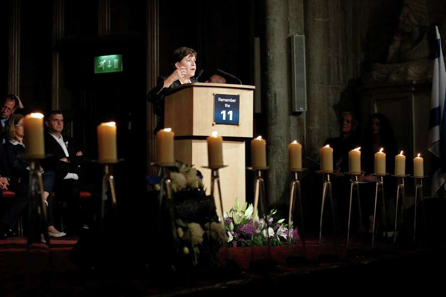 Ankie Spitzer, widow of one of the members of Israeli Olympic team who was killed, addresses the guests as 11 candles burn in memory during a memorial ceremony at Guildhall in London to commemorate the 40th anniversary of the terrorist attack at the 1972 Munich Olympic Games where 11 members of Israeli Olympic team were killed, Monday, Aug. 6, 2012. (AP Photo/Sang Tan) Photo: Sang Tan