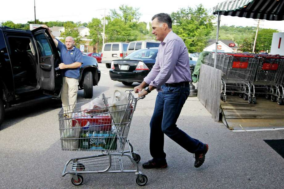 Republican presidential candidate, former Massachusetts Gov. Mitt Romney pushes a shopping cart after buying groceries at  Hunter's Shop and Save supermarket in Wolfeboro, N.H., Monday, Aug. 6, 2012. (AP Photo/Charles Dharapak) Photo: Charles Dharapak
