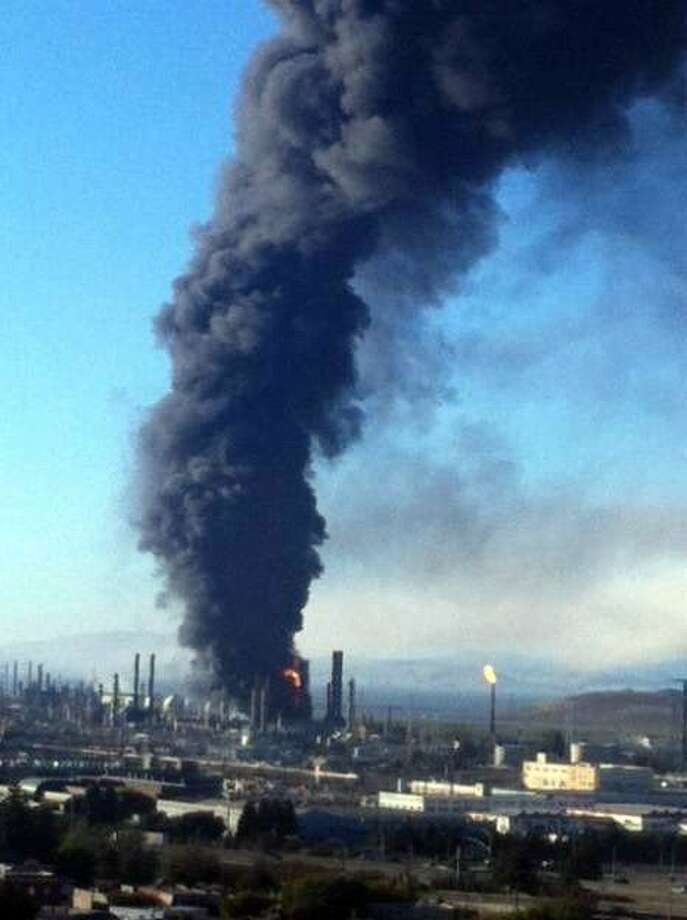 A fire in is seen at the Chevron Refinery in Richmond, Calif. Photo: Courtesy Tom Butt