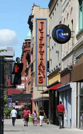 View of Jillian's, center and  R Bar, to the right, on North Pearl Street on Monday Aug. 6, 2012 in Albany, NY.  Figure 10 is visible in the background, with a black awning over the sidewalk.   (Philip Kamrass / Times Union) Photo: Philip Kamrass / 00018741A