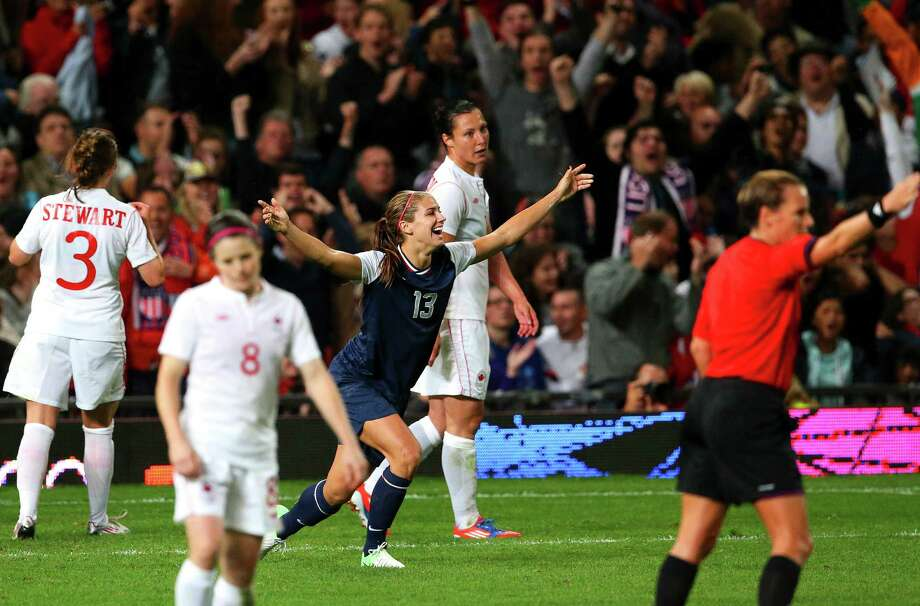 U.S. forward Alex Morgan (13) celebrates after scoring the game-winning goal against Canada during the women's soccer semifinals at the 2012 Summer Olympic Games in London, Aug. 6, 2012. The U.S. won the match and will advance to the finals against Japan. (Doug Mills/ The New York Times) Photo: DOUG MILLS / NYTNS