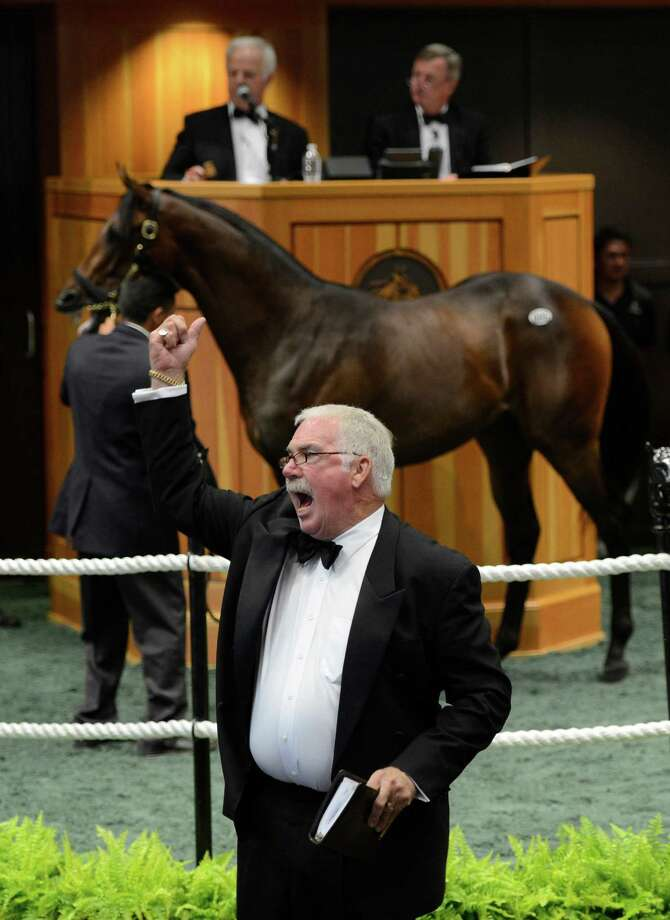 Bid spotter Steve Dance takes a bid on a sales yearling at the Fasig Tipton Sales pavilion in Saratoga Springs, N.Y. Aug 6, 2012. (Skip Dickstein/Times Union) Photo: Skip Dickstein