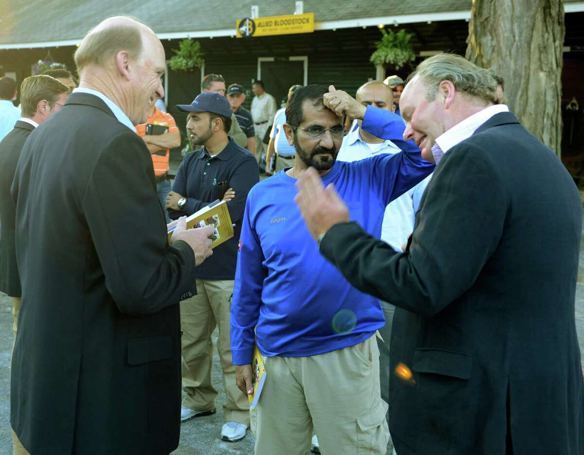 Sheik Mohammed is surrounded by racing personalities at the Fasig Tipton Sales grounds in Saratoga Springs, N.Y. Aug 6, 2012. (Skip Dickstein/Times Union)
