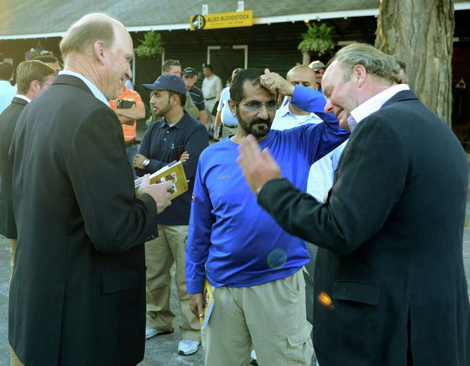 Sheik Mohammed is surrounded by racing personalities at the Fasig Tipton Sales grounds in Saratoga Springs, N.Y. Aug 6, 2012. (Skip Dickstein/Times Union) Photo: Skip Dickstein