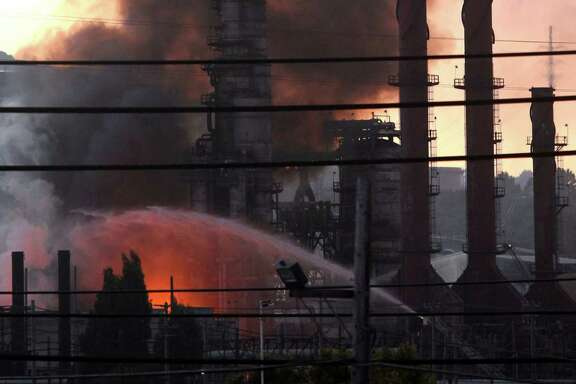 Fire crews battle the Chevron refinery fire in Richmond on Aug. 6, 2012.
