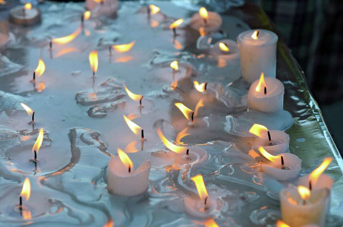 Candles burn for the victims of Sunday's deadly shooting at a Sikh Gurudwara, or temple, in Wisconsin, at the East Greenbush Gurudwara on Monday evening Aug. 6, 2012 in East Greenbush, NY. (Philip Kamrass / Times Union)