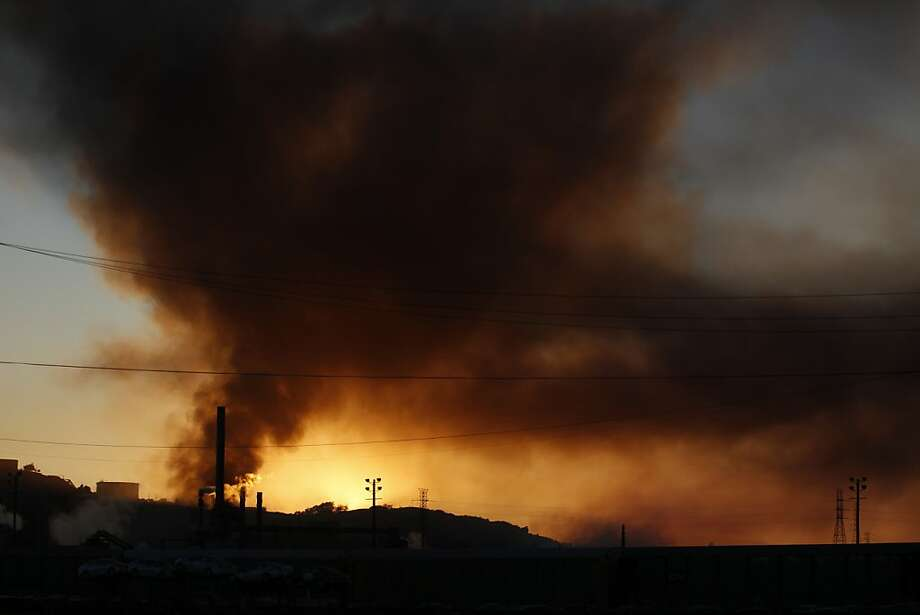 Plumes of smoke emanate from the Chevron oil refinery on Monday, August 6, 2012 in Richmond, Calif. Photo: Beck Diefenbach, Special To The Chronicle