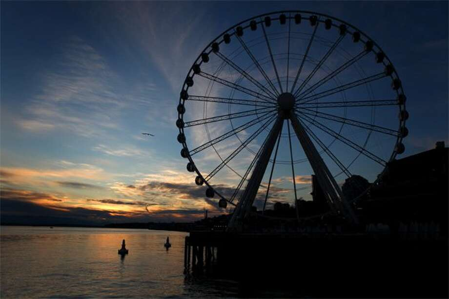 Seattle's Great Wheel is on the waterfront. Six people can fit on a gondola (eight if they''re small kids) and the gondola weight limit is 1,300 pounds. (Joshua Trujillo/seattlepi.com file)