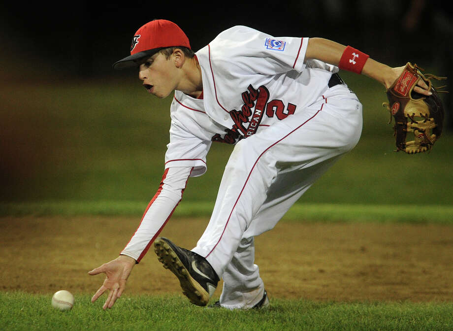 Fairfield American shortstop Will Lucas barehands a ground ball during the first inning of their game with Scarborough, Maine at the 2012 Little League Eastern Regional in Bristol on Monday, August 6, 2012. Photo: Brian A. Pounds / Connecticut Post