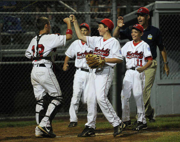 Fairfield American players celebrate their 15-2 victory over Scarborough, Maine at the 2012 Little League Eastern Regional in Bristol on Monday, August 6, 2012. Photo: Brian A. Pounds / Connecticut Post