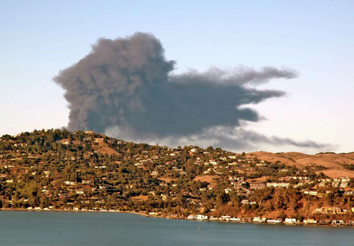Fire at Richmond Chevron refinery as seen from Sausalito across Belvedere Island