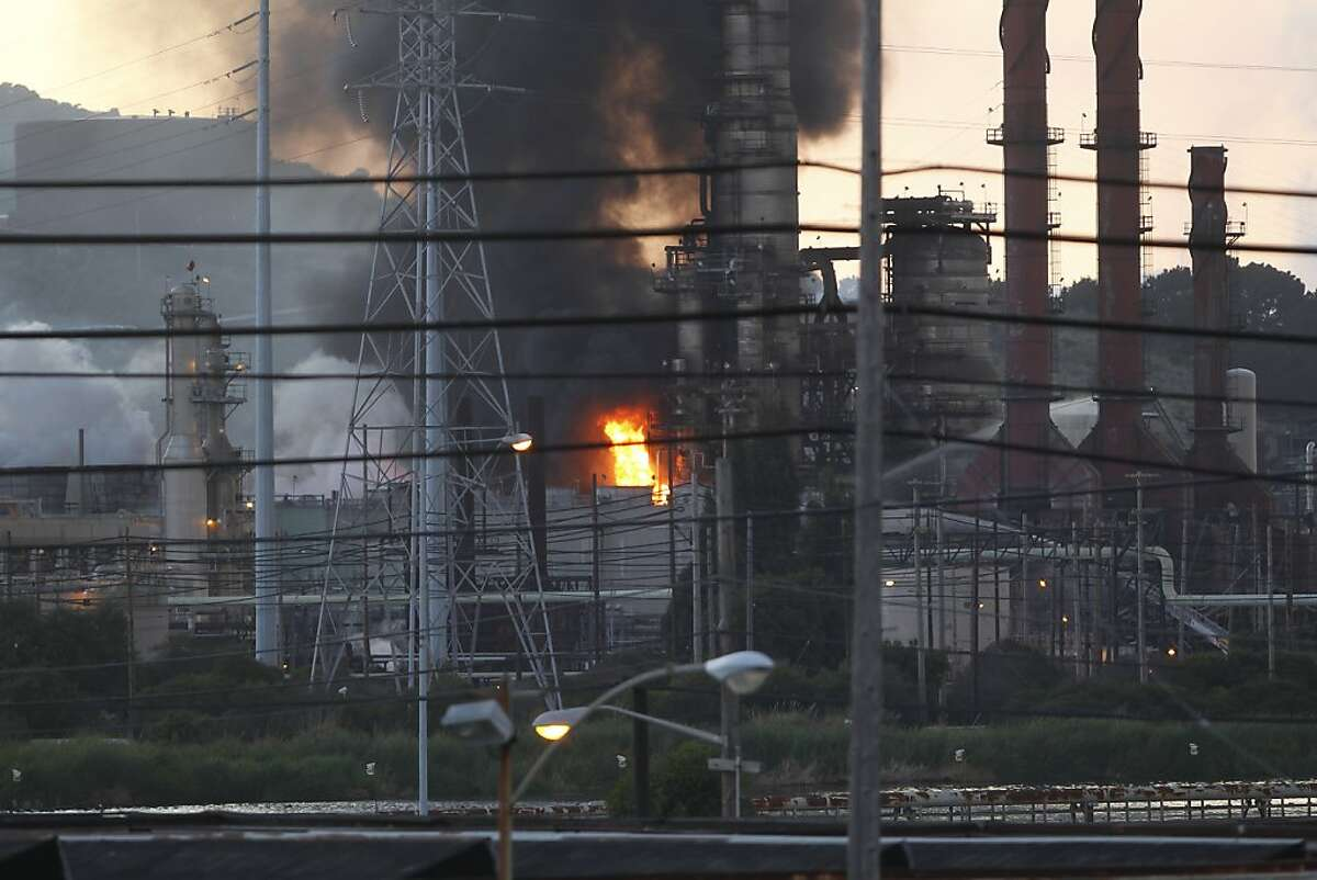 Smoke and fire raises from the Chevron Oil Refinery fire n Richmond, Calif. on Monday, Aug. 6, 2012.