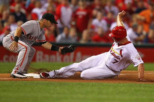 Matt Holliday #7 of the St. Louis Cardinals slides safely into third base against Marco Scutaro #19 of the San Francisco Giants at Busch Stadium on August 6, 2012 in St. Louis, Missouri.  (Photo by Dilip Vishwanat/Getty Images) Photo: Dilip Vishwanat, Getty Images