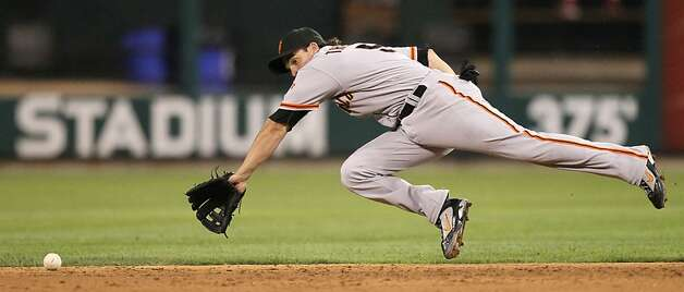 San Francisco second baseman Ryan Theriot is unable to reach a single by St. Louis Cardinals' Jon Jay in fourth-inning action at Busch Stadium in St. Louis, Missouri, Monday, August 6, 2012. (Chris Lee/St. Louis Post-Dispatch/MCT) Photo: Chris Lee, McClatchy-Tribune News Service