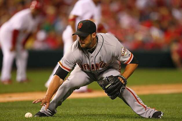 Reliever George Kontos #70 of the San Francisco Giants picks up an infield hit against the St. Louis Cardinals at Busch Stadium on August 6, 2012 in St. Louis, Missouri.  (Photo by Dilip Vishwanat/Getty Images) Photo: Dilip Vishwanat, Getty Images