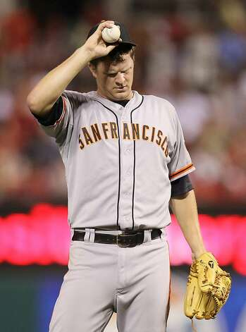 San Francisco starting pitcher Matt Cain adjusts his cap before facing pinch hitter Matt Carpenter with the bases loaded in the sixth inning at Busch Stadium in St. Louis, Missouri, Monday, August 6, 2012. (Chris Lee/St. Louis Post-Dispatch/MCT) Photo: Chris Lee, McClatchy-Tribune News Service
