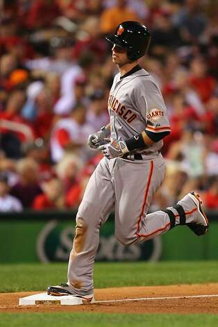 : Buster Posey #28 of the San Francisco Giants rounds third base after hitting a solo home run against the St. Louis Cardinals at Busch Stadium on August 6, 2012 in St. Louis, Missouri.  (Photo by Dilip Vishwanat/Getty Images) Photo: Dilip Vishwanat, Getty Images