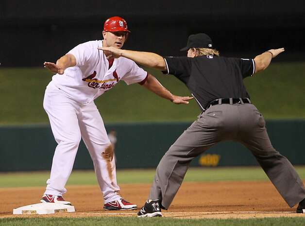 St. Louis Cardinals' Matt Holliday and third base umpire Brian Runge agree that Holliday is safe at third after he advanced on a fly out by Carlos Beltran in the sixth inning during a game against the San Francisco Giants at Busch Stadium in St. Louis, Missouri, Monday, August 6, 2012. (Chris Lee/St. Louis Post-Dispatch/MCT) Photo: Chris Lee, McClatchy-Tribune News Service