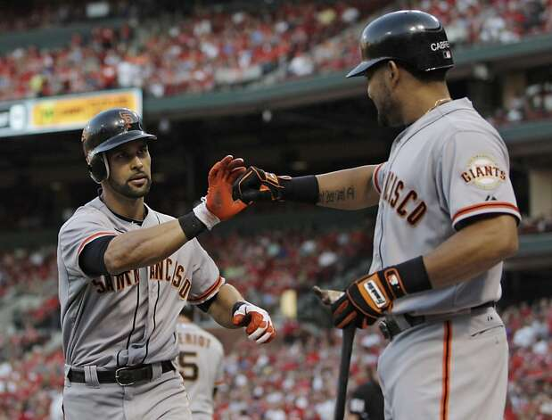 San Francisco Giants' Angel Pagan, left, celebrates with teammate Melky Cabrera after hitting a solo home run in the first inning of a baseball game against the St. Louis Cardinals, Monday, Aug. 6, 2012 in St. Louis. (AP Photo/Tom Gannam) Photo: Tom Gannam, Associated Press