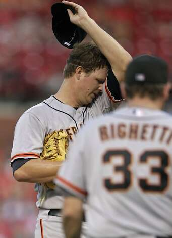 San Francisco Giants starting pitcher Matt Cain regroups as pitching coach Dave Righetti walks to the mound in the second inning of a baseball game against the St. Louis Cardinals, Monday, Aug. 6, 2012 in St. Louis. (AP Photo/Tom Gannam) Photo: Tom Gannam, Associated Press