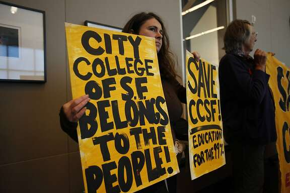 Beth Seliman, holds a sign as Jack Scott, Chancellor of California Community Colleges, speaks during a San Francisco City College Board of Trustees Retreat at City College of San Francisco's Ocean Campus in San Francisco, Calif. on Monday, Aug. 6, 2012. City College is facing possible closure after its accreditation status from the Accrediting Commission for Community and Junior Colleges is in jeopardy from various leadership and financial problems.