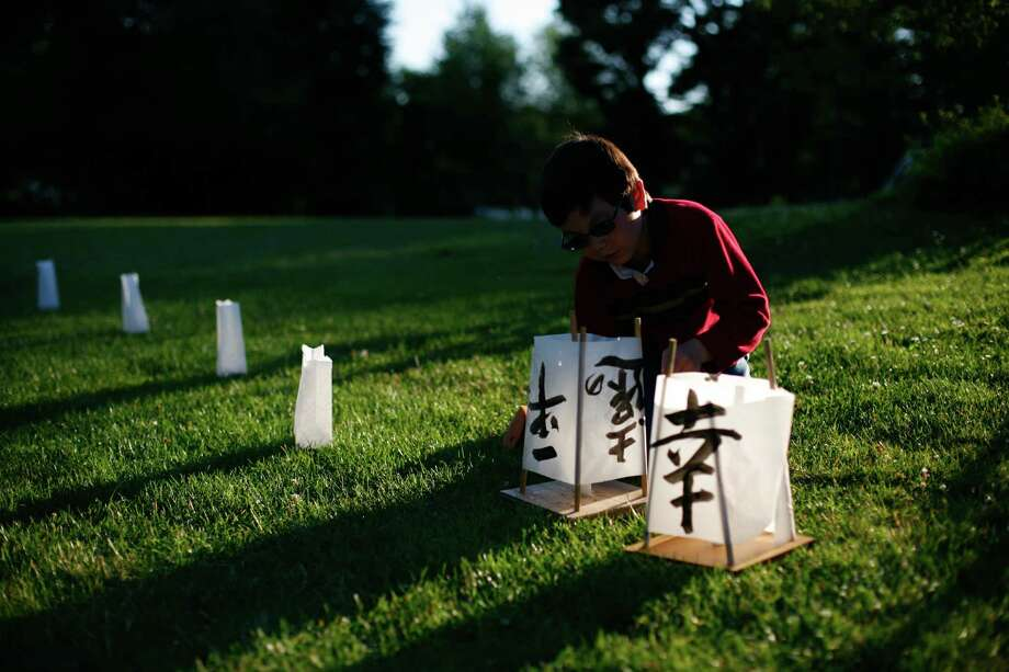 Danilo Murata, 7, checks out his lantern during the From Hiroshima to Hope Latern Ceremony held at Green Lake on Monday, Aug. 6, 2012. From Hiroshima to Hope is an annual Lantern Floating Ceremony which is held to promote peace and remember victims of Hiroshima/Nagasaki and all victims of war. Photo: Sofia Jaramillo / SEATTLEPI.COM