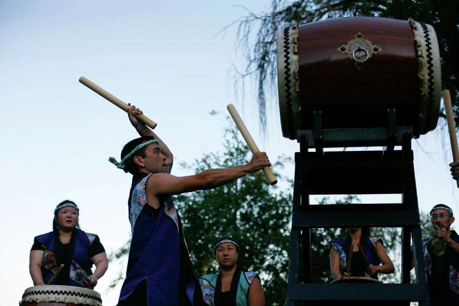 The Seattle Kokan Taiko group perform during the From Hiroshima to Hope Latern Ceremony held at Green Lake on Monday, Aug. 6, 2012. From Hiroshima to Hope is an annual Lantern Floating Ceremony which is held to promote peace and remember victims of Hiroshima/Nagasaki and all victims of war. Photo: Sofia Jaramillo / SEATTLEPI.COM