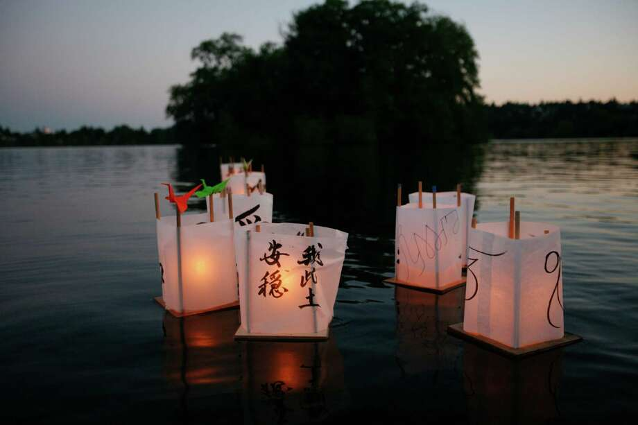 Lanterns float in Green Lake during the From Hiroshima to Hope Latern Ceremony held at Green Lake on Monday, Aug. 6, 2012. From Hiroshima to Hope is an annual Lantern Floating Ceremony which is held to promote peace and remember victims of Hiroshima/Nagasaki and all victims of war. Photo: Sofia Jaramillo / SEATTLEPI.COM