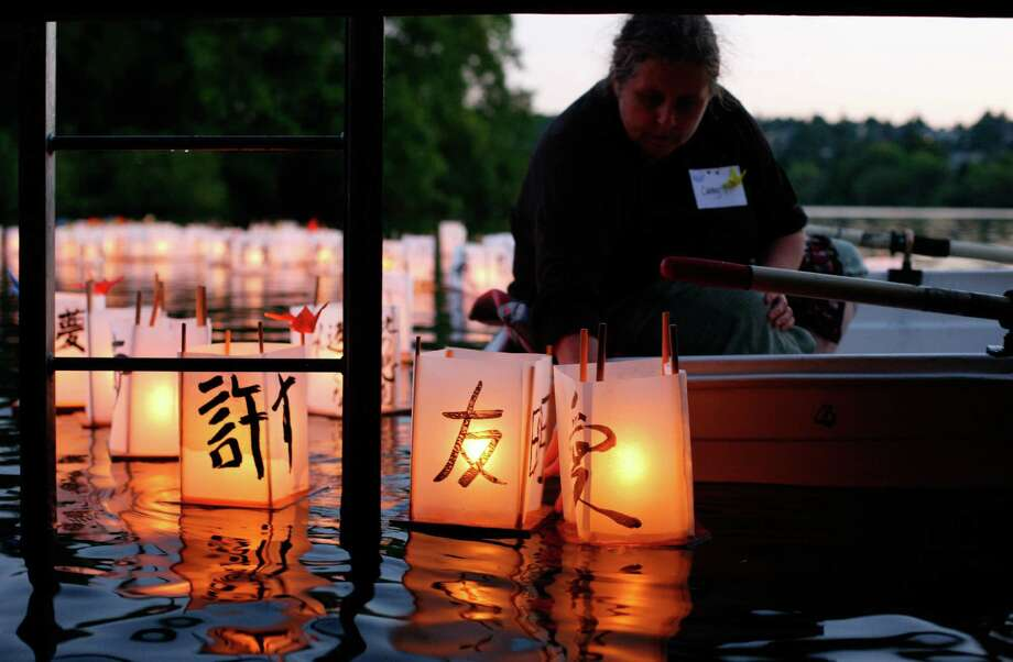 Cathy Tuttle puts lanterns into the water during the From Hiroshima to Hope Latern Ceremony held at Green Lake on Monday, Aug. 6, 2012. From Hiroshima to Hope is an annual Lantern Floating Ceremony which is held to promote peace and remember victims of Hiroshima/Nagasaki and all victims of war. Photo: Sofia Jaramillo / SEATTLEPI.COM