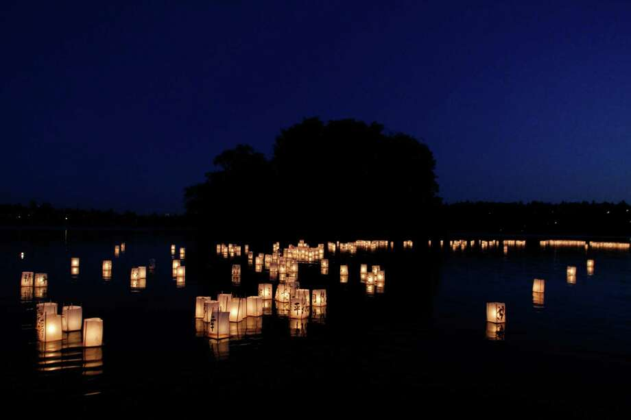 Hundreds of lanterns float in Green Lake during the From Hiroshima to Hope Latern Ceremony held at Green Lake on Monday, Aug. 6, 2012. From Hiroshima to Hope is an annual Lantern Floating Ceremony which is held to promote peace and remember victims of Hiroshima/Nagasaki and all victims of war. Photo: Sofia Jaramillo / SEATTLEPI.COM