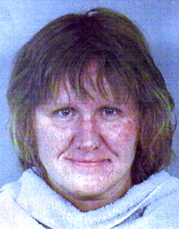 Dena Schlosser in a 2004 booking mug. / Collin County Jail via The Dalla