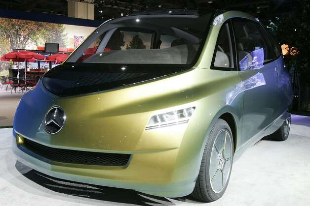 A Mercedes-Benz bionic concept vehicle lies on display during an innovation symposium at the Washington Convention Center June 7, 2005 in Washington, DC. The car was created after a study was done on the tropical boxfish. (Photo by Alex Wong/Getty Images)