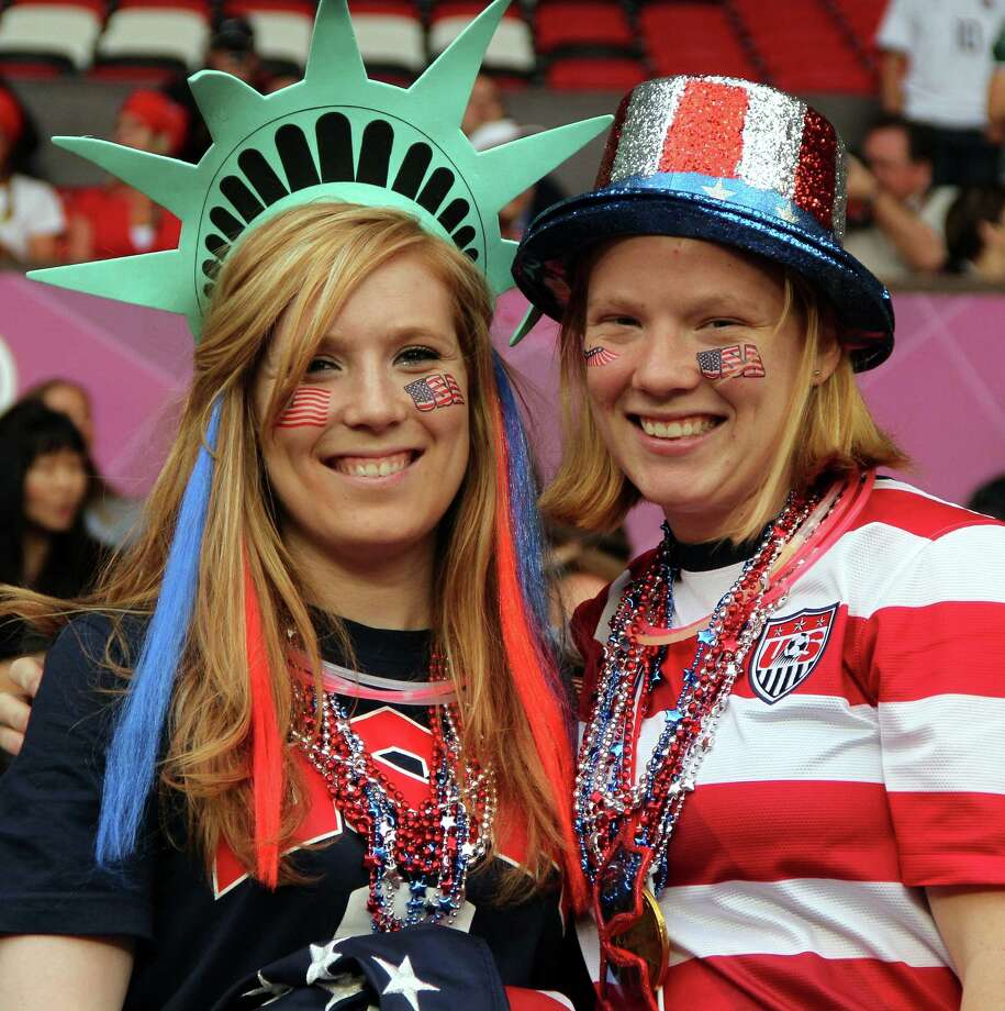 MANCHESTER, ENGLAND - AUGUST 06:  USA fans during the Women's Football Semi Final match between Canada and USA, on Day 10 of the London 2012 Olympic Games at Old Trafford on August 6, 2012 in Manchester, England. Photo: Stanley Chou, Getty Images / 2012 Getty Images